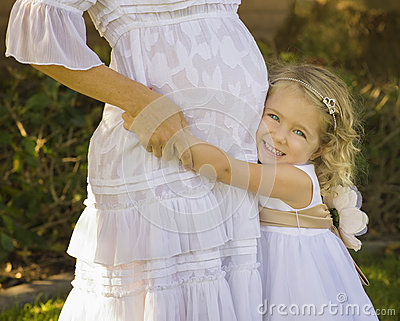 Happy Little Girl With Pregnant Mother