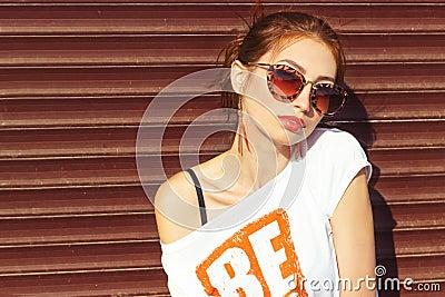 Hot redhead in sun glasses