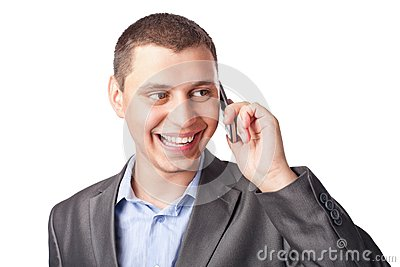 Smiling happy young businessman with mobile