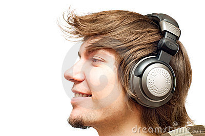 Smiling happy young man in a headphones