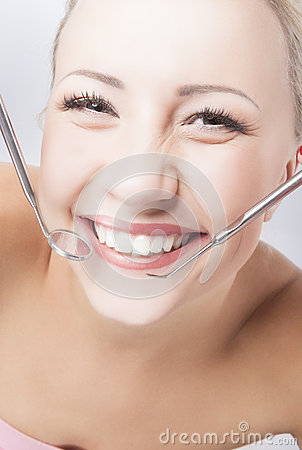 Smiling Healthy Woman With Dentist Mirror and Spatula Stock Photo