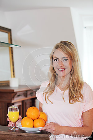 Smiling healthy woman with fresh oranges