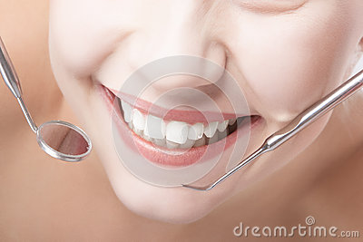 Smiling Healthy Woman Mouth Closeup With Dentist Mirror and Spat Stock Photo