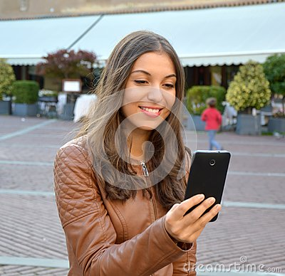 Free Smiling Hipster Girl Is Reading Pleasant Text Message From Her Friend On Mobile Phone Outdoor Royalty Free Stock Images - 101304559