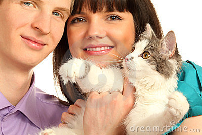 Smiling husband and wife hold cat isolated
