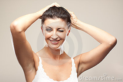Smiling italian mature woman on gray