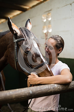 Free Smiling Jockey Standing By Horse Stock Photography - 97407412