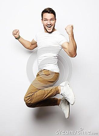 Free Smiling Joyful Man Jumping On A White Background. Royalty Free Stock Photos - 111143288