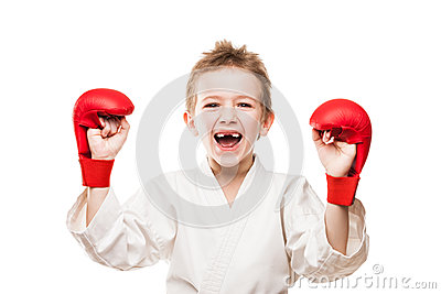 Smiling karate champion boy gesturing for victory