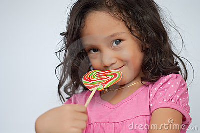 Smiling kid with candy