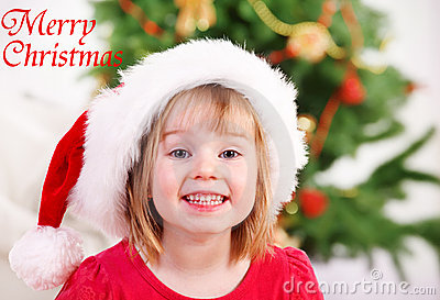 Smiling kid in Christmas hat