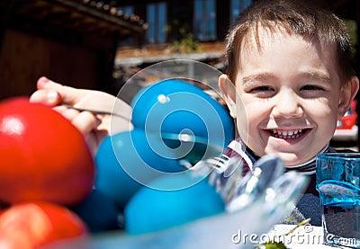 Smiling kid easter eggs
