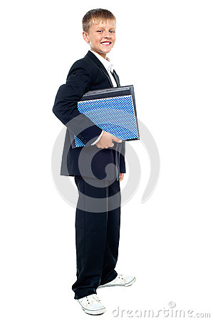 Smiling kid holding files, young business boy