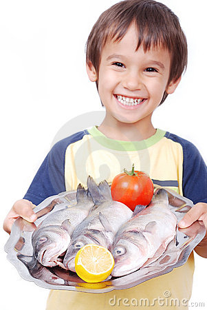 Free Smiling Kid With Three Fresh Fishes On Table Royalty Free Stock Image - 10027616