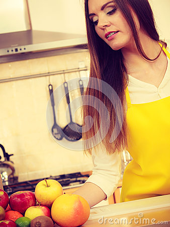 Smiling lady in kitchen. Stock Photo