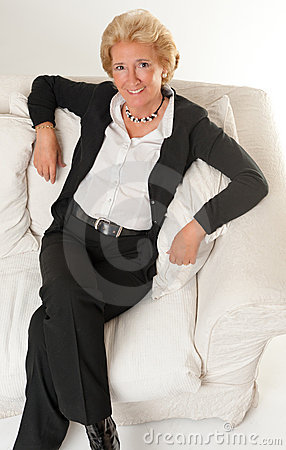 Smiling lady on a sofa