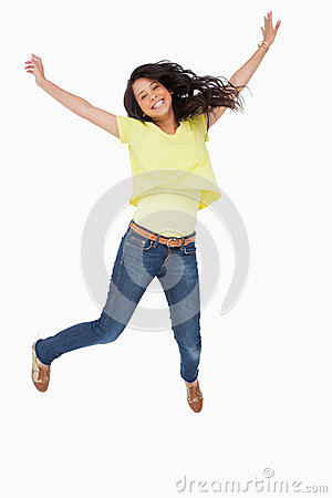 Smiling Latin student jumping