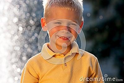 Smiling little blonde boy