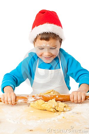 Smiling little bot kneading for Christmas cooking