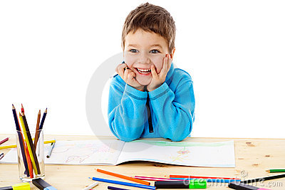 Smiling little boy draw with crayons