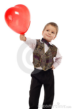 Smiling little boy gives a red balloon