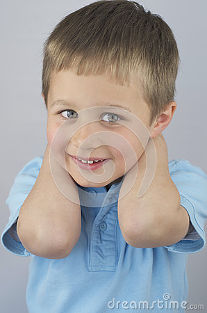 Smiling Little Boy With Hands Behind His Head