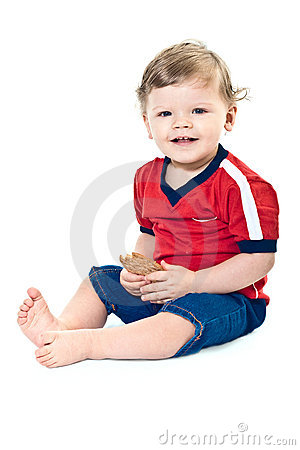 Smiling little boy holds on cookies