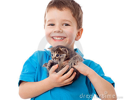 Smiling little boy with kitty in hands