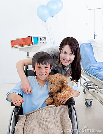 Free Smiling Little Boy Sitting On Wheelchair Stock Photos - 13342273