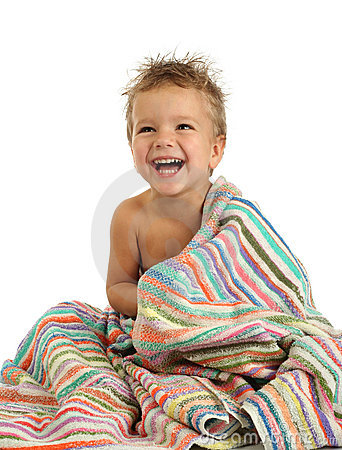 Smiling little boy in towel