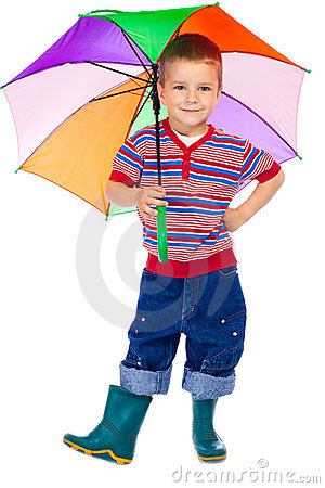 Smiling little boy with umbrella