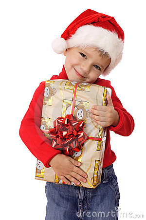 Smiling little boy with yellow Christmas gift box