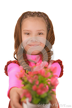 Smiling little girl with bouquet of flower