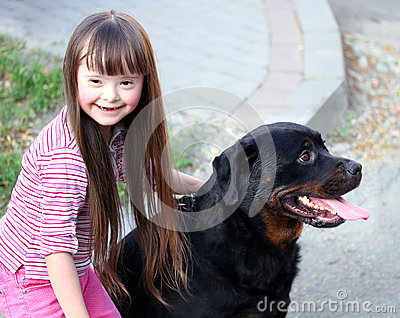 Smiling little girl with dog
