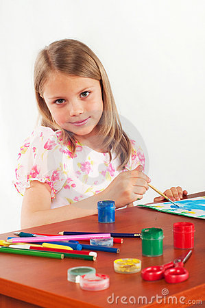 Smiling little girl drawing picture, paints, hobby