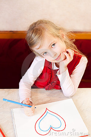 Smiling little girl draws heart. Valentine s Day
