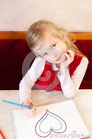 Smiling little girl draws heart. Valentine s Day