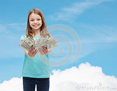 Smiling little girl giving dollar cash money