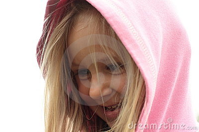 Smiling little girl in a hood