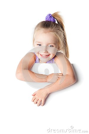 Smiling little girl looking over empty board