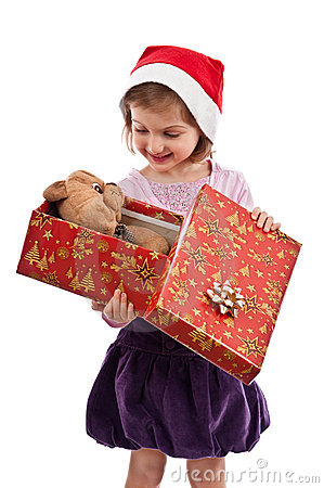 Smiling little girl looking at teddy bear present