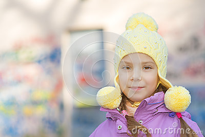 Smiling little girl in pink coat