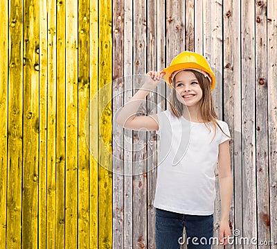 Smiling little girl in protective helmet