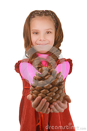 Smiling little girl shows big pine cones