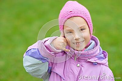 Smiling little girl simulates