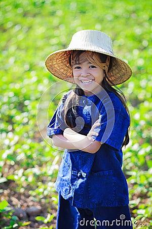 Smiling little girl in thai s farmer dress