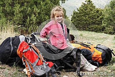 Smiling little hiker on a rest