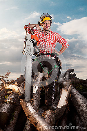 Smiling lumberjack with chainsaw
