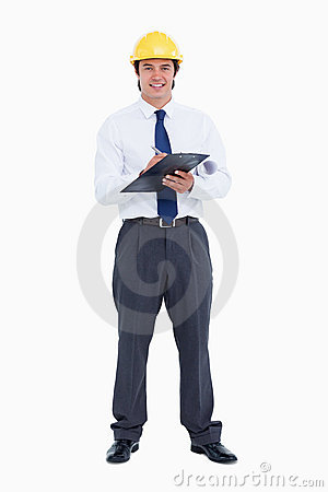 Smiling male architect with pen and clipboard