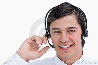 Smiling male call center agent in a conversation